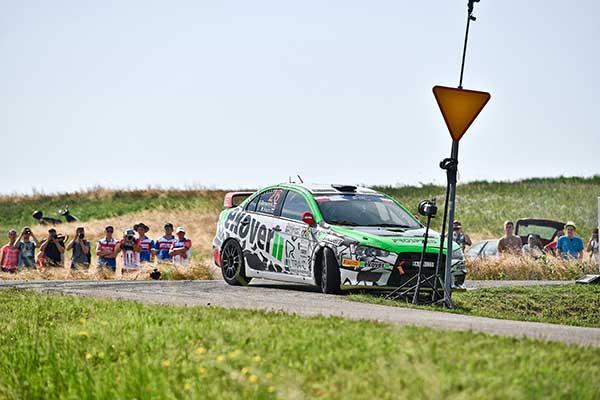 green mitsubishi lancer with black EVO Corse wheels