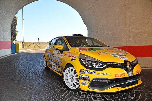 A yellow car at Rally Friuli Venezia Giulia with EVO Corse wheels